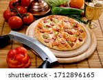 Small photo of The indispensable choice of those who love sausage in pizza is hot dog pizza