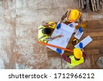 High angle view of engineer and architect discussing building plan at construction site,Group of builders having conversation about building plan. - stock photo