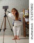 a little girl in a white kimono ... | Shutterstock . vector #1713570802