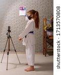 a little girl in a white kimono ... | Shutterstock . vector #1713570808