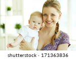 portrait of happy young mother... | Shutterstock . vector #171363836