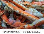 alaskan king crab legs on ice... | Shutterstock . vector #1713713662