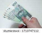 polish zloty in hand  paper... | Shutterstock . vector #1713747112