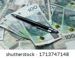 close up of money and pen ... | Shutterstock . vector #1713747148