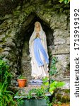 Virgin Mary Statue At A Grotto...