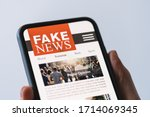 Online Fake News On A Mobile...