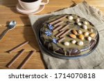 Homemade chocolate brownie cake with caramel cream and almonds with cup of coffee on wooden  background and linen textile. Side view, hard light, close up. - stock photo