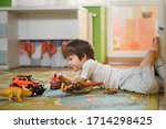 Little Boy Playing Toy Cars On...