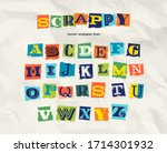 letters cut and torn from... | Shutterstock .eps vector #1714301932