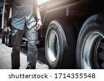 Truck Driver Walking Around A...