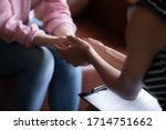Small photo of Close up of female doctor hold woman patient hands help on personal therapy session, psychologist or counselor show understanding and care, support depressed suffering client on treatment