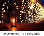 ramadan lantern on the table.... | Shutterstock . vector #1714923808