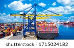 Small photo of Container cargo ship at industrial port in import export global business worldwide logistic and transportation, Container ship unloading freight shipping, Container cargo vessel boat freight.