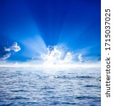 Sun Rays With Clouds On Blue...