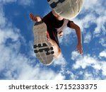 young man running against the... | Shutterstock . vector #1715233375