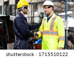 Two Man Worker Hand Shake At...