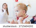 Baby Girl Wearing A Hearing Ai...