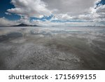 Bonneville Salt Flats after a rainstorm. Reflections of sky and clouds are mirrored on the flat salt playa near the Bonneville Speedway in western Utah, USA Records were set between 1935-1970 here.