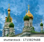 Golden domes of the church on the sunset sky background. Old  Orthodox Church in Poltava in place the Battle of Poltava. Ukraine.