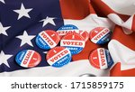 Small photo of Button of I Voted Today for the US elections with american flag in background.