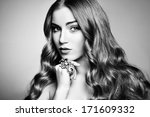 Portrait of young beautiful woman with jewelry. Beauty photo - stock photo