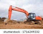 Excavator Digs Dirt During...