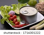 canned food on white dish with...