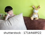 boy at home with bunny in face... | Shutterstock . vector #1716468922
