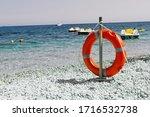 Orange Life Ring On The Seashore