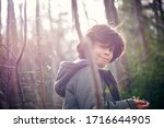 young boy picks flowers for his ... | Shutterstock . vector #1716644905