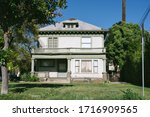 Small photo of Old decrepit home in need of repair - Scary abandoned house - Fixer Upper in Need of Repairs