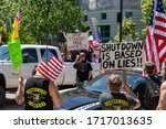 Small photo of RALEIGH, NORTH CAROLINA / USA - APRIL 28, 2020: ReOpenNC Rally / protesters converge downtown Raleigh, NC to protest COVID-19 restrictions and appeal to reopen businesses