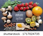 Small photo of Assortment of food to naturally boost immune system. Healthy eating for strong immune system. Immune-boosting foods. Concept of helpful ways to strengthen immunity naturally. Kiwi, turmeric, garlic...