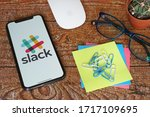 Small photo of Yogyakarta, Indonesia - April 29, 2020; Slack Iphone Screen with Glases and Stickynotes. Slack is a cloud-based proprietary instant messaging platform. #Slack