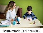 boy doing homework with mother... | Shutterstock . vector #1717261888