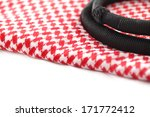 Small photo of A close up image of a Ghutrah also known as the Keffiyeh along with the agal and skull cap. These items of clothing are usually worn by men as a head-dress in Arab Countries