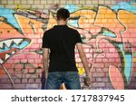 Young Graffiti Artist With...
