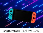 Photo of blue and orange video game console