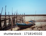 Old Boat Stranded In The Mud...