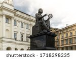 Nicolaus Copernicus Monument in Warsaw, Poland, bronze statue of a Polish astronomer from 1830, on background of old buildings