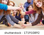 students stacking fists for... | Shutterstock . vector #171910892