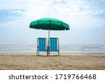 Empty chairs and umbrella on ocean beach. Closed beaches during covid-19 pandemic. Huanchaco, Peru