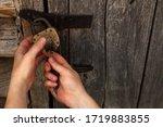 Hands Open Padlock With Keys....