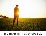Young Farmer Stands In The...