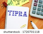Business concept meaning Tax Increase Prevention and Reconciliation Act of 2005 TIPRA with phrase on the piece of paper.
