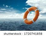Orange Lifebuoy On The Water....