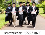 Stock photo group of cute multiracial graduates walking on college campus 172074878
