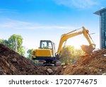 Excavators Excavate Earth At...