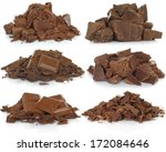Broken chocolate bar set on white background   - stock photo