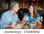 Mature Couple Enjoying Meal At...